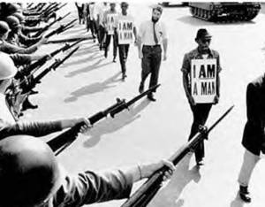 I AM A MAN. The march meant to have America recognize that fact. Note the lone brave white male willing to march among black men.