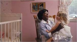 Viola Davis as Aibileen in film version of The Help and young actress as Mae Mobley