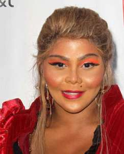 2012 photo fo Lil Kim.Entertainer's skin has been lightened and she's had plastic surgery
