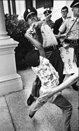 Scene two of Child waving American Flag and his confrontation with police